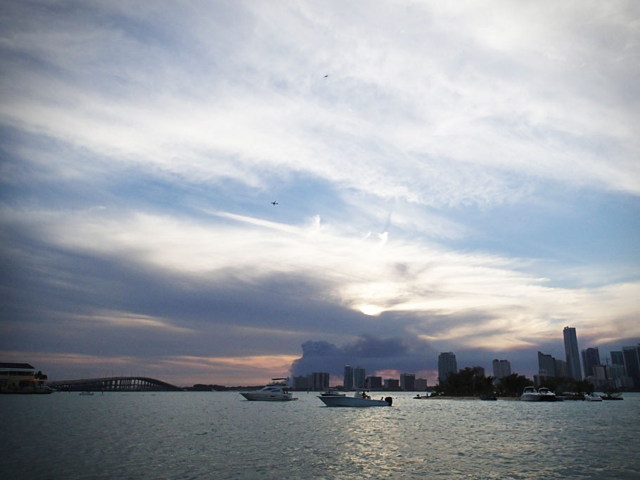 The view from Marina Stadium of the harbor entrance. The Rusty Pelican on the left, the Rickenbacker Causeway Bridge in the middle, and the little island on the right.