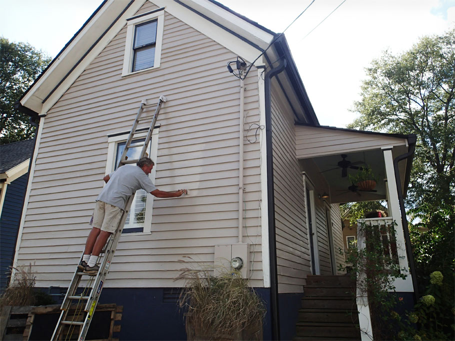Greg puts the finishing touches on Laura's house, painted summer of 2014.