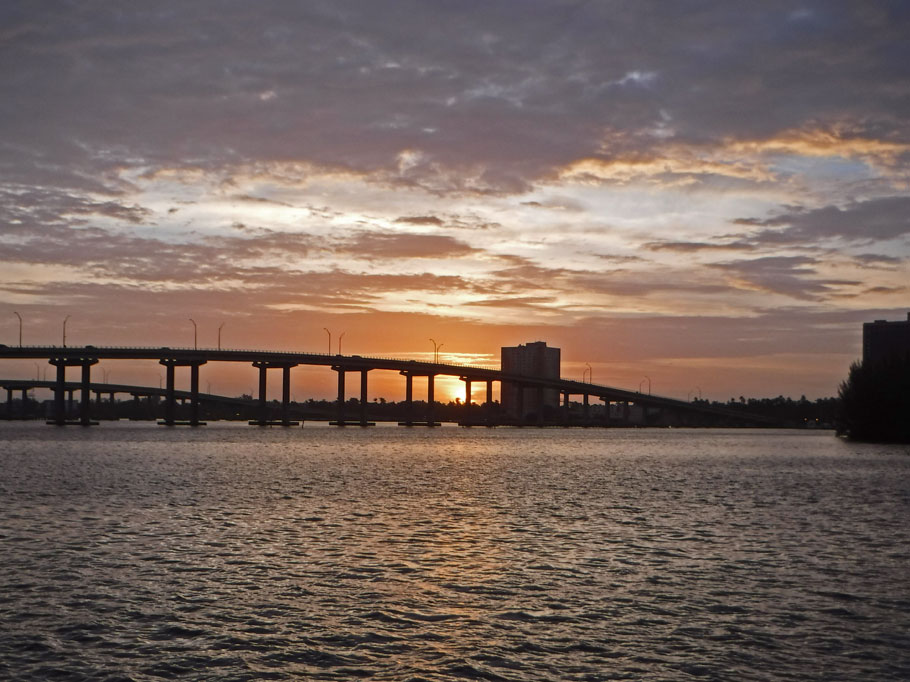 The sun rises over the Edison Bridge in Fort Myers.