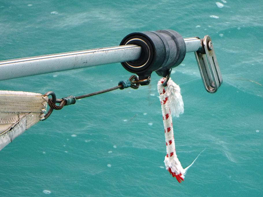 Since the forestay is longer than the boat, the end hung off the back, bouncing up and down, slapping in the water on our return to Key West. Here is the top of the forestay and the broken halyard hanging off the rear of the boat.