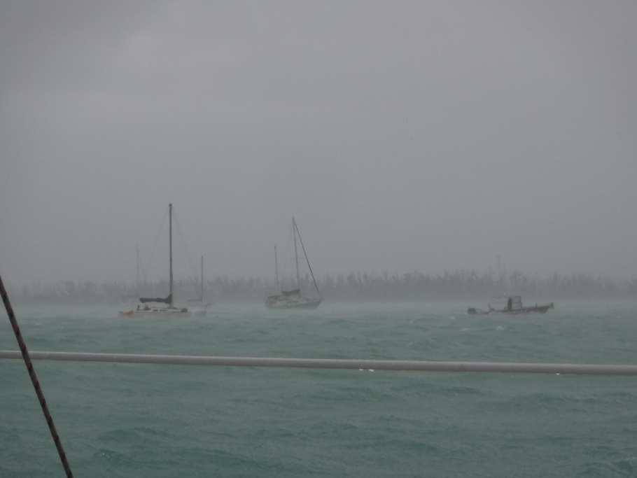 A boat being towed during a storm.