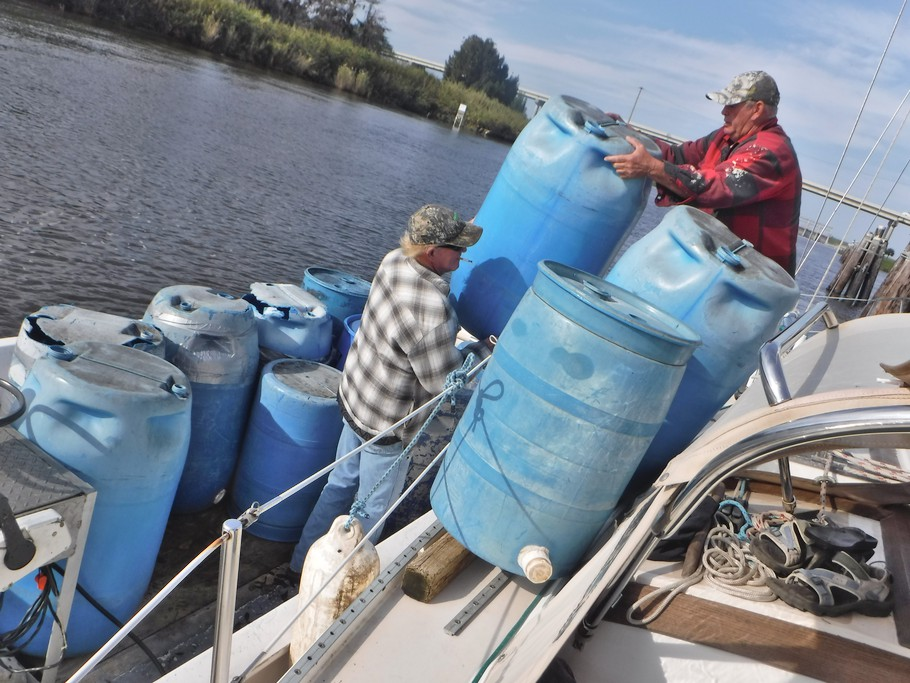 Billy and his helper start to load barrels on Blue Wing.