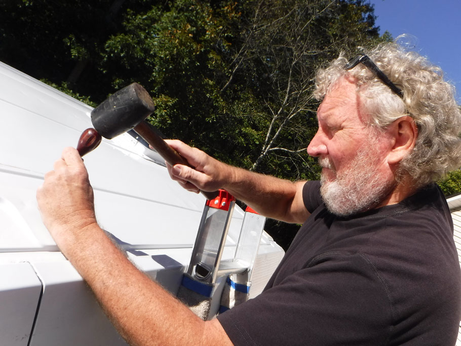 Need to drill holes to mount the solar panels. First, punch the metal with an awl. Then the drill bit will stay in the indentation instead of wandering around when you start to drill.