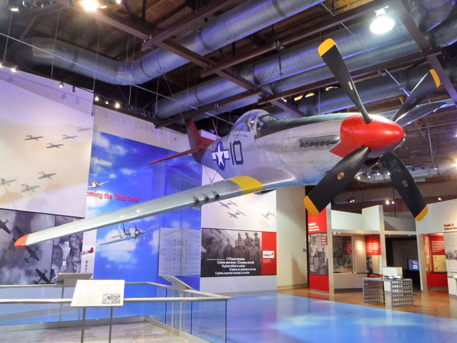 "P-51 plane. Tuskegee Airmen painted the tails of their planes red. Due to this distictive coloring and because the Tuskegee Airmen were known to never to abandon bombers in their care, they were known as the ""Red Tail Angels."""