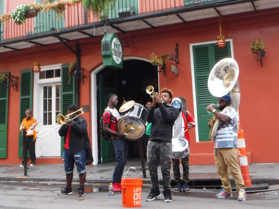 Jazz band playing for tips in the French Quarter right outside of Ariadne's favorite bar.