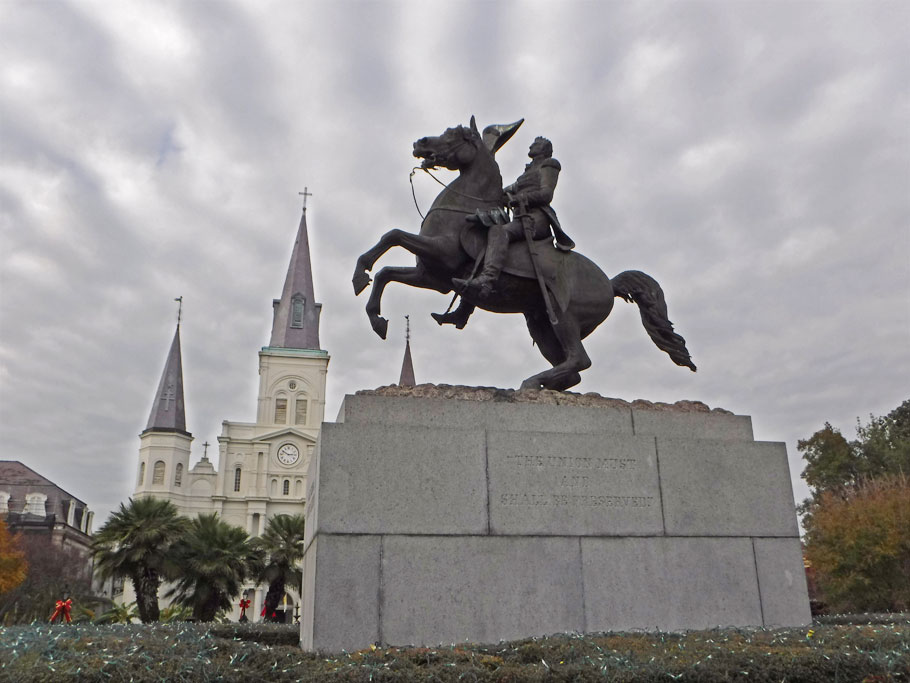 Statue of Jefferson Davis with St. Louis Cathedral in the background.