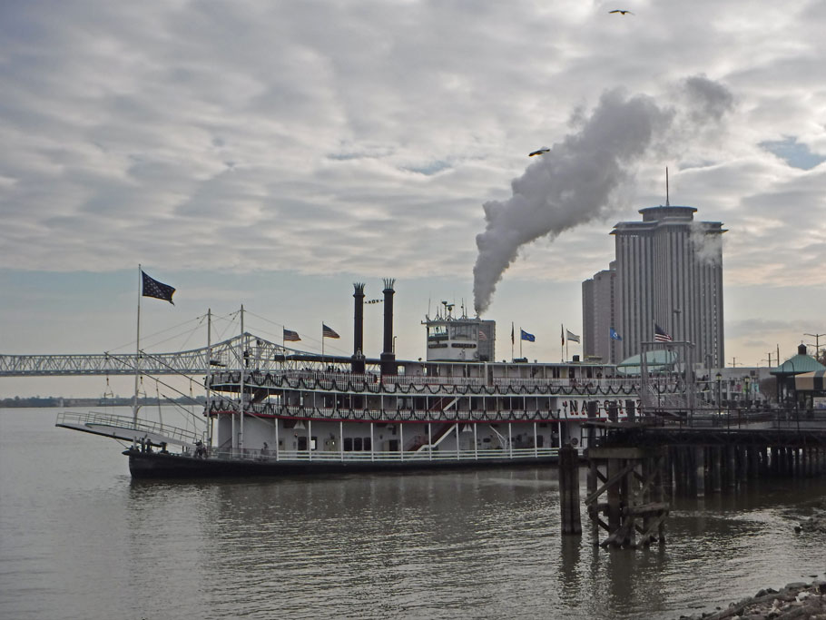 The steamboat Natchez undocks and heads up the Mississippi River.