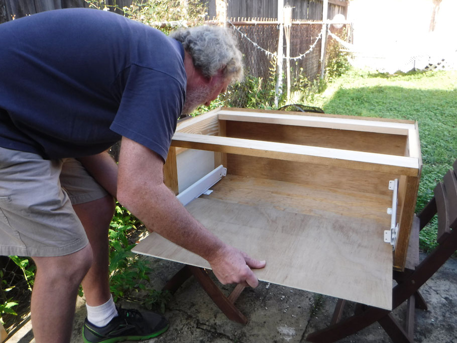 Ariadne left us on our own over Christmas and flew to Colorado with her boyfriend. This gave us some time to work on another project for the van. Here Greg is building a cabinet with a sliding drawer.