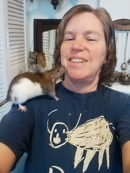 Veronica climbing on my shoulder. They are extremely curios creatures.
