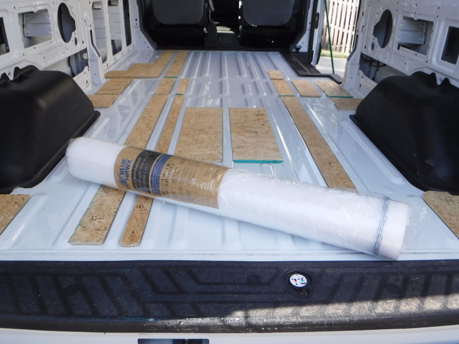 We cut some OSB to make sub-flooring in selected spots. Usually wide gaps or places that would be bearing weight. The roll of cushioned plastic is made for hardwood floors. We put a layer between the sub-flooring and plywood.