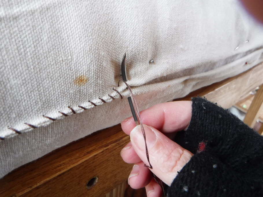 Sewing inner cover closed. It's cold out here.
