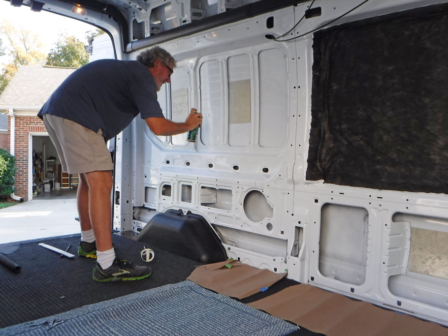 For the large pieces we sprayed 3M adhesive on the van wall and white side of the Thinsulate. It held very well.