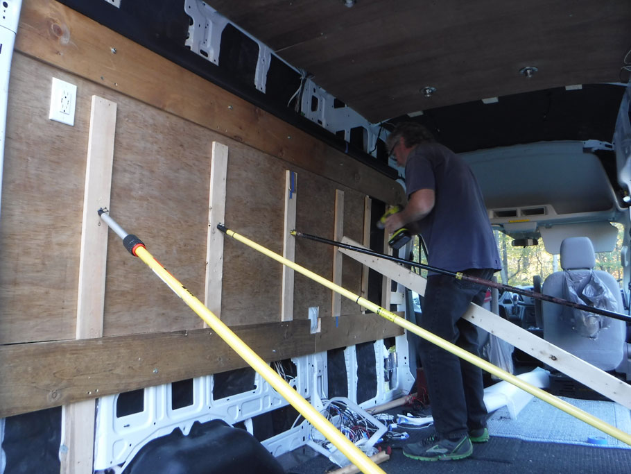 We used Liquid Nails (and some screws) to attach the interior walls to the studs. Temporary braces held the walls in place overnight.