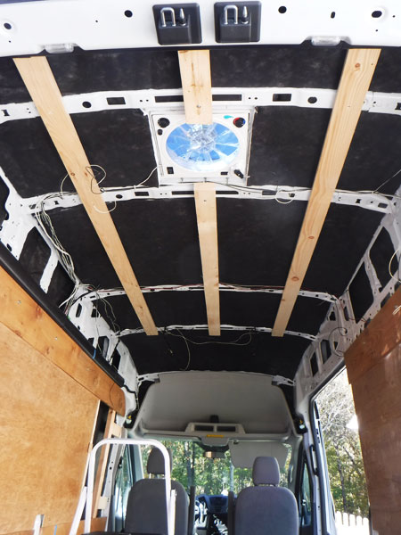 We bolted furring strips to the roof for the ceiling.